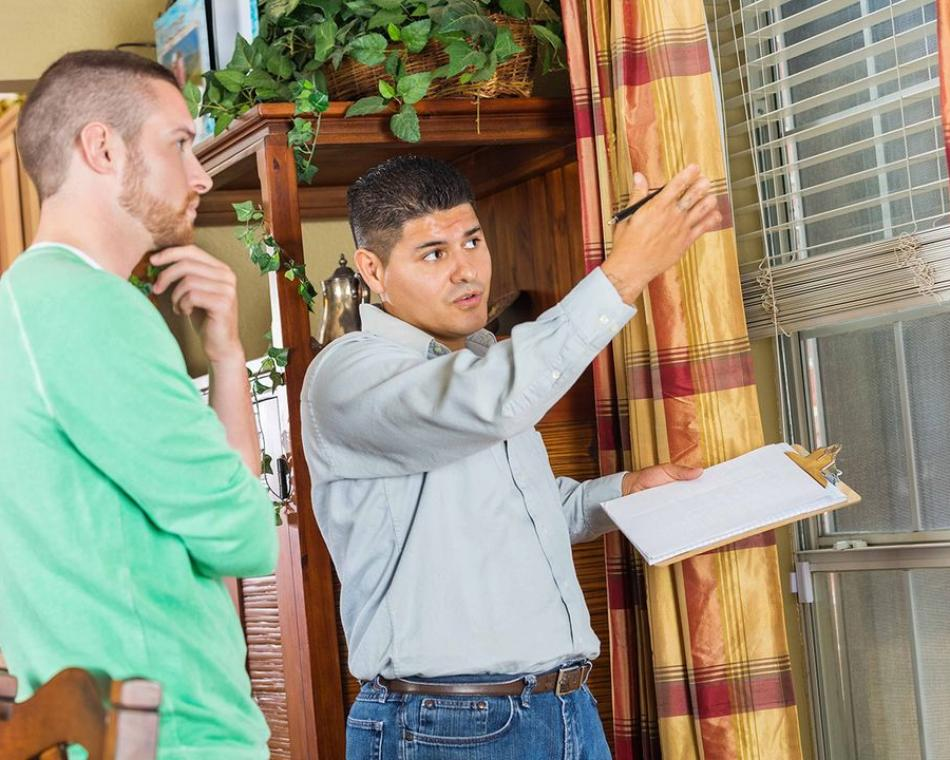 Claims Adjuster Explaining Home Damage