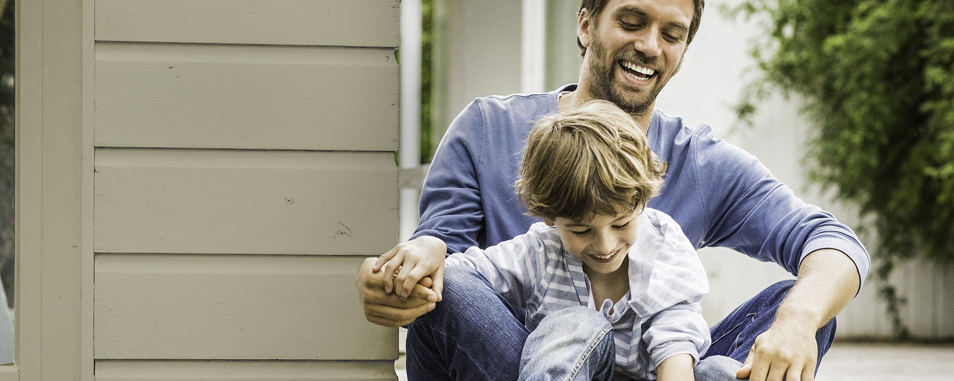 Father and son enjoying homeowners protection